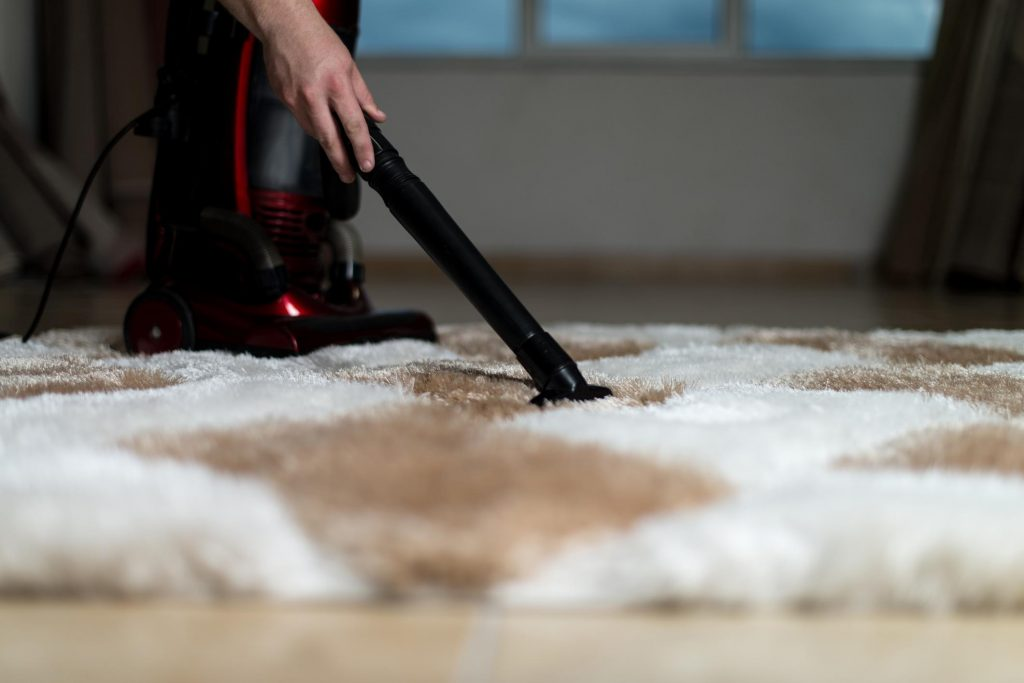 Cleaning an oriental rug with a vacuum cleaner